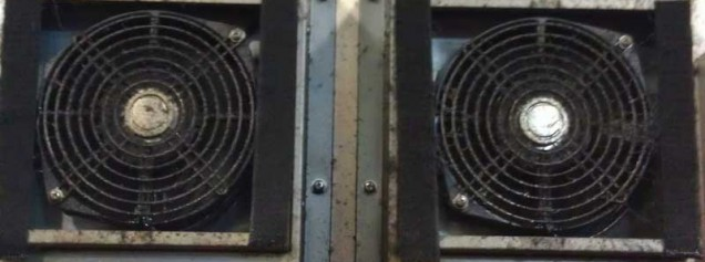 Drive Cabinet Air Condition fan contamination due to lack of filters. Cooling fan failures followed by drive failure due to overheat condition.